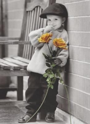 small boy has yellow flowers