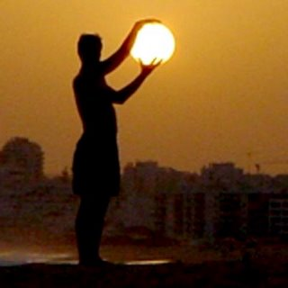 person holds the sun