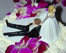 bride drags groom wedding cake
